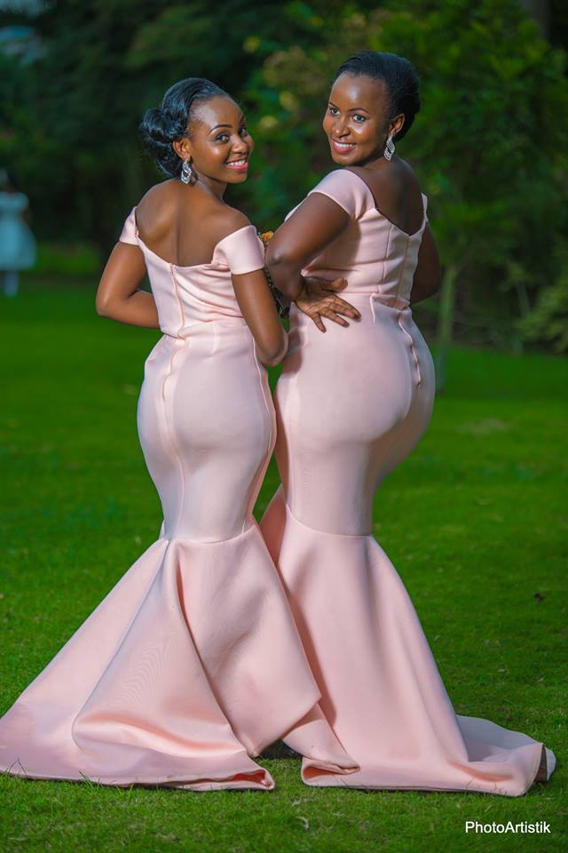 Daphine's bridesmaids clad in pink dresses at photo shoot by Photo Artistik