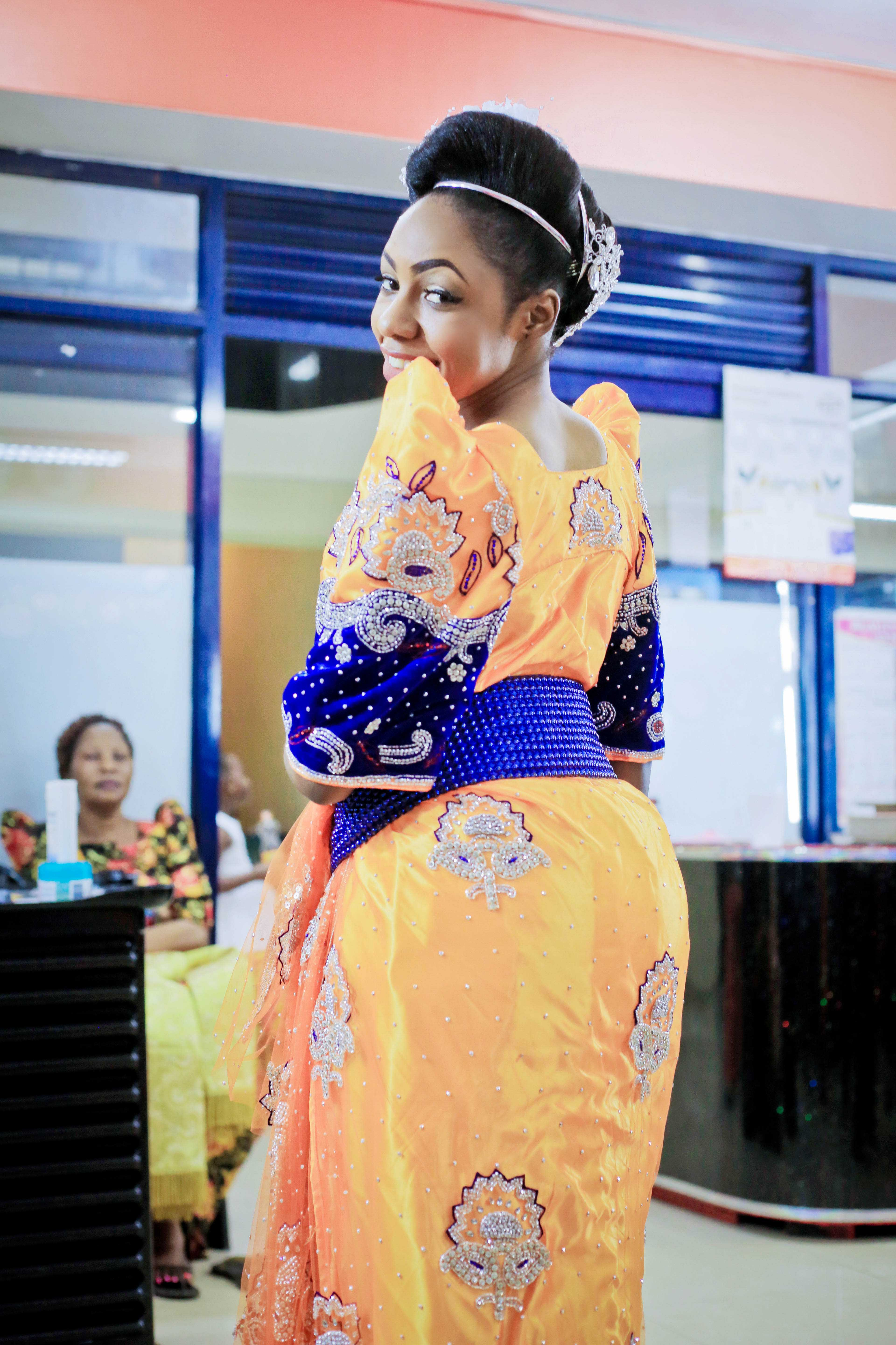 Asha dazzles in a sequined yellow and blue gomesi, photo by Agapix Photography