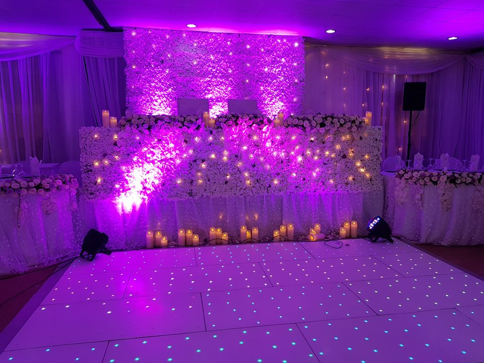 Wonderful wedding high table decorations with lighting at Rivonia Suites
