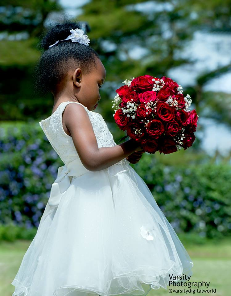 A flower girl during a wedding photo shoot with Varsity Digital WORLD