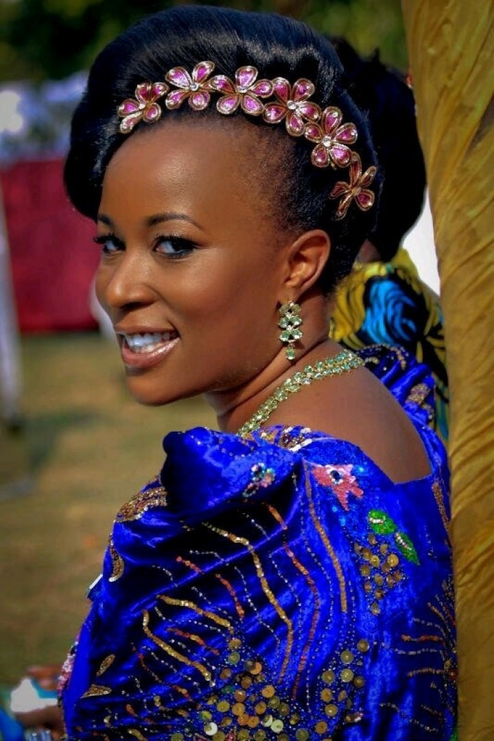 A beautiful bride in a blue gomesi, Makeup & hairdo by Salon Lords & Ladys