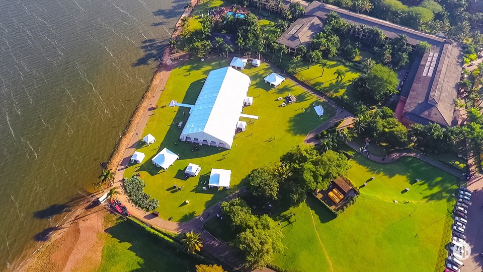 A drone photo of a Lakeside wedding reception at Speke Resort Munyonyo
