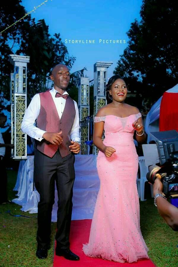 A bride and groom dance at their reception, bride's changing  dressed tailored by Peponi Clothings