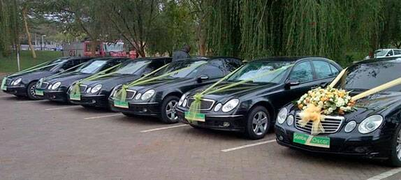 A fleet of bridal cars from Wedding Car Hire Uganda