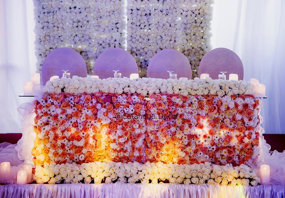 Wonderful high table decorations from Dr Charles Bate & Dr Martha's wedding by Catahena Decor