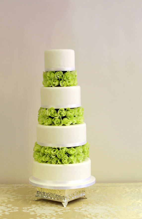 Four tier cake with a blend of flowers from Elieonai Cakes
