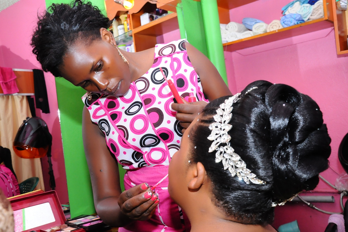 Bride having her makeup done at Vision Bridal Salon, City Center Complex in Kampala