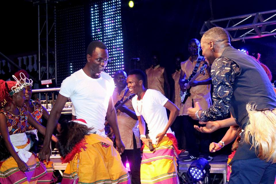Meseach Ssemakula challenges The Dance N' Beats Cultural Troupe dancer at Hotel Africana