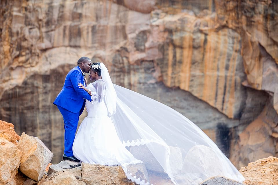 A bride and groom during a wedding photo shoot with Frame Media at the stone querry in Munyonyo