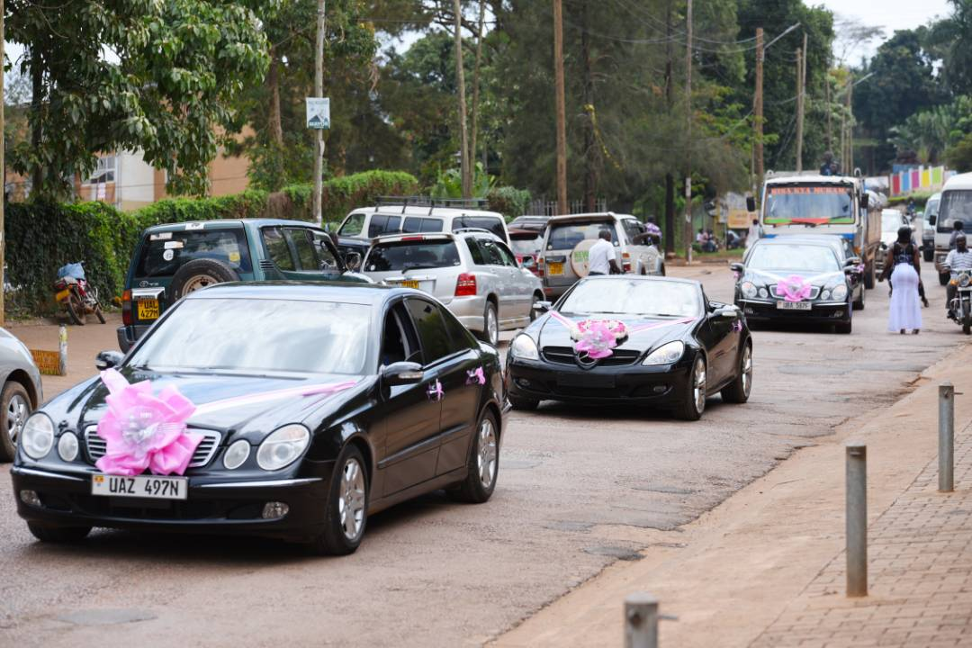 A fleet of bridal cars drive through the streets of Kampala, photo by Ksan Events