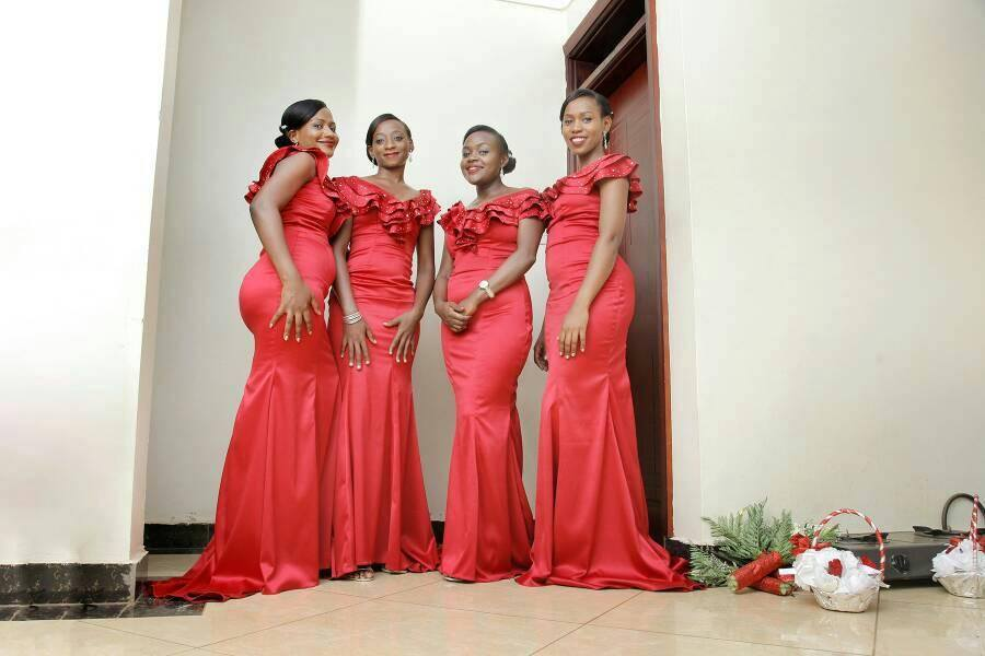 Bridesmaids clad in nice red dresses from Peponi Clothings