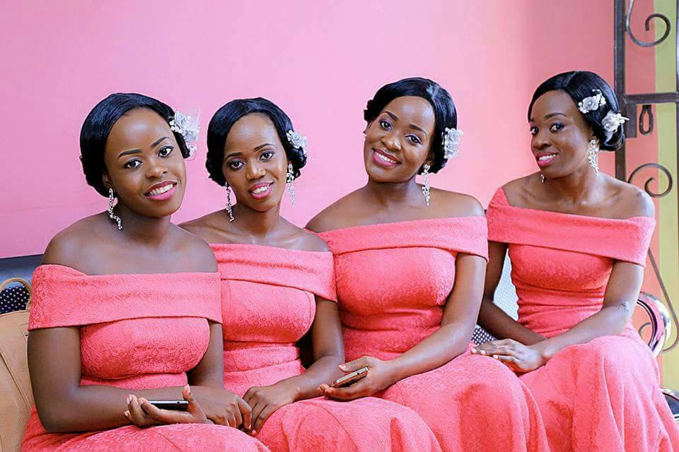 Bridesmaids in off shoulder red outfits from Bridal Lounge Kampala