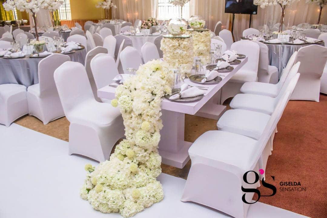 Joshua and Faridah's white wedding decor at Silver Springs Hotel