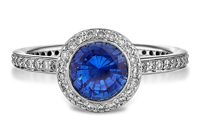A halo wedding ring with a blue stone from Ahmed Jeweller and Diamond Shop