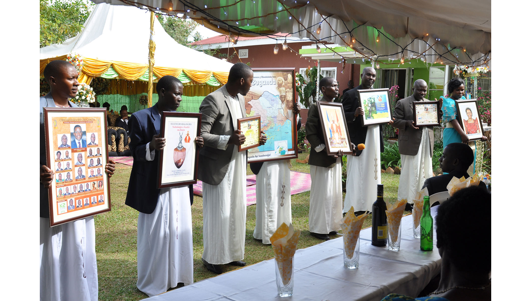 Guests present gifts to the family of the bride at a customary wedding captured by Dream Occasions Ug