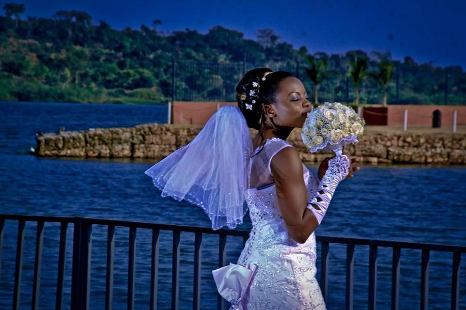 A beautiful Ugandan bride at a wedding photo shoot at the Commonwealth Resort Munyonyo