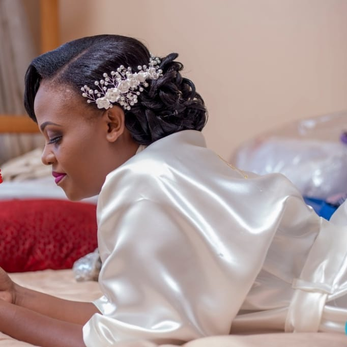 Neat bridal hairdo by Serene Beauty