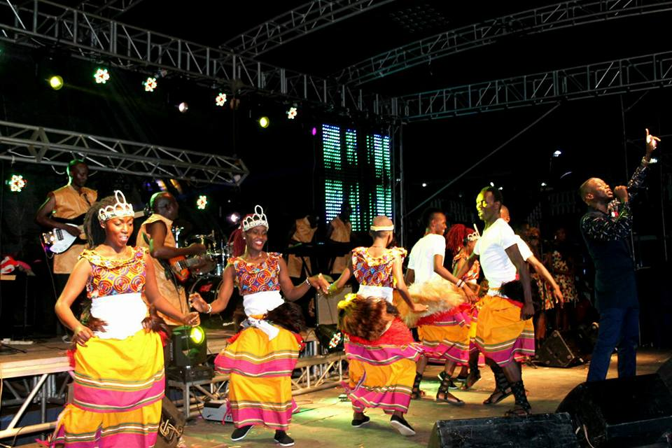 The Dance N' Beats Cultural Troupe dance as Meseach Ssemakula performs at his concert
