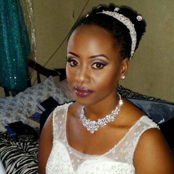 A Ugandan bride with makeup by Thenameis.Usher Makeup Artistry
