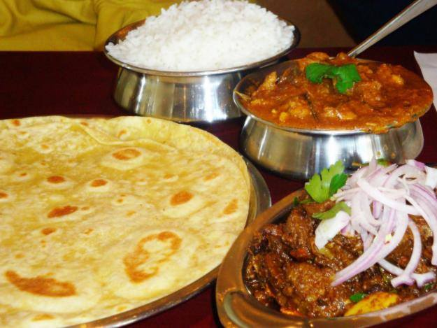 Chapatti, beef sauce and rice from Sunrise Catering Services Limited