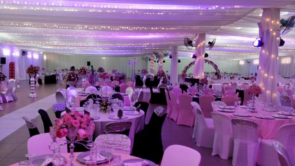 Indoor venue wedding decorations by Mugagga Events