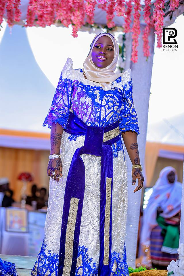 A smart Nabiirah smiles during her traditional wedding with Moustapher