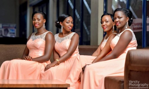 Bridesmaids clad in beautiful peach dresses, Photo by Varsity Digital WORLD