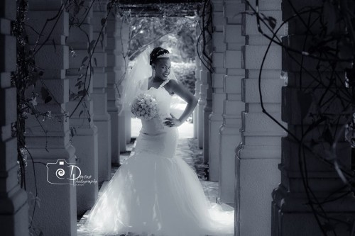 A Uganda bride is a strap trumpet wedding gown captured by Devine Photography
