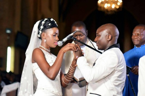 A bride and groom exchanging their Namirembe Cathedral