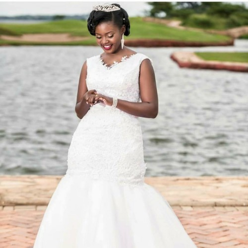 A beautiful bride dressed by Exquisite Bridals