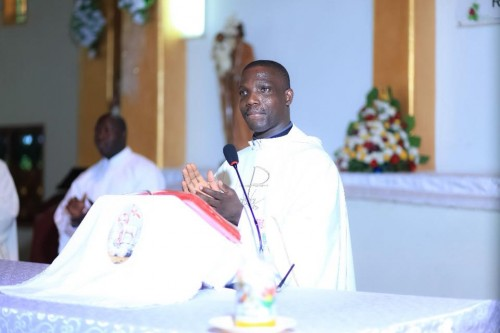 Father Deogratius Kiibi Kateregga presiding over Mark and Julian's wedding
