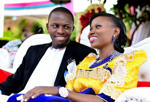 A happy bride and groom at a customary wedding covered by Lenz Media