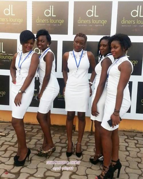 Girls from Trinity Ushers in white dresses