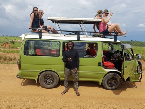Excited tourists during a tour in Uganda