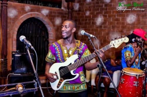 K'angie Band guitarist performing