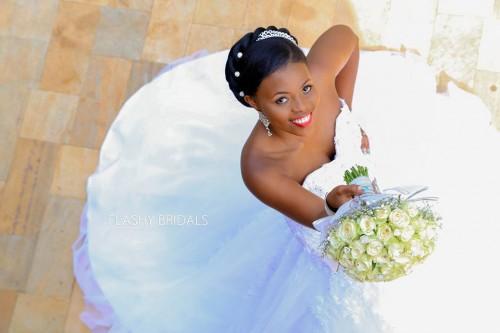A bride in a strapless wedding dress by Flashy Bridals