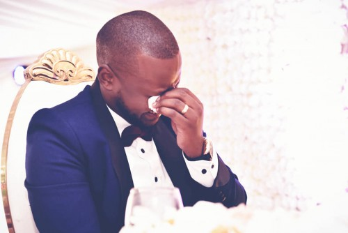 A groom shades tears of joy at his wedding, shots by Zebra Image International Digital Studio