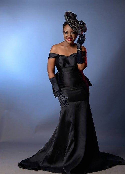 Music star Solome Basuuta slays in a fitting black off-shoulder dress