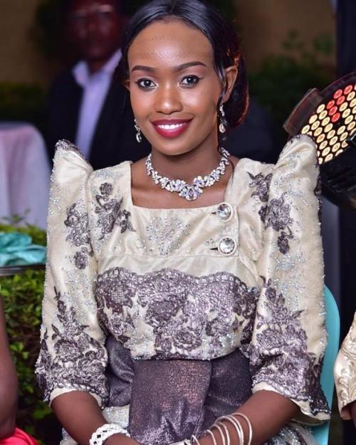Dorah dressed in an exquisite traditional Kiganda attire (Gomesi)