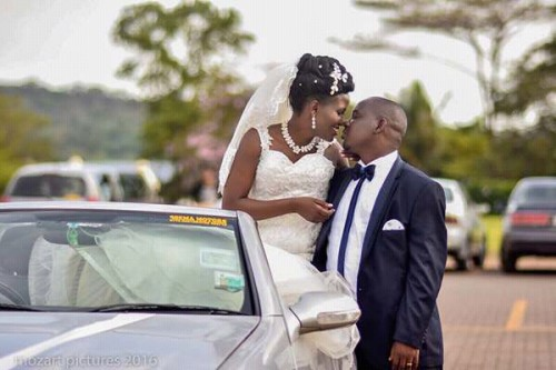 A bride & groom pose in set during their wedding photo shoot
