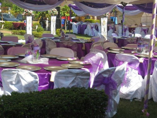 Purple and white themed wedding decorations at Bunga Leisure Gardens