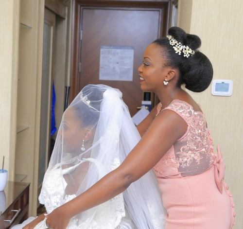 A bride and her maid of honor, shots powered Oscar Ntege Photography
