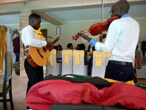 The Tabs Uganda performing at a small party in Kampala