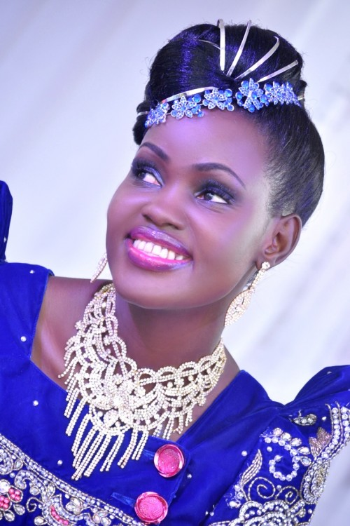 Rosette clad in a blue gomesi at her introduction
