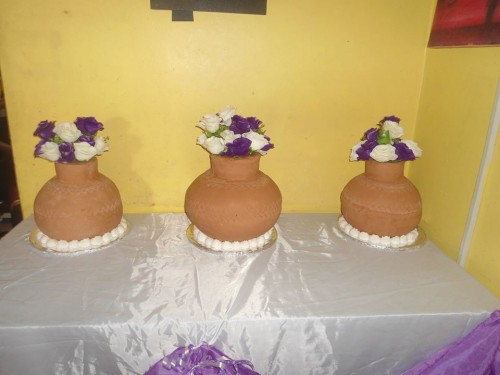 A flower pot inspired cake by New Day Bakery & Catering Services