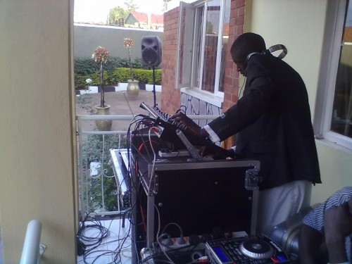 A deejay playing music at an event powered by Blaze Events