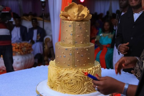 Rhemiel Ray's gold inspired customary wedding cake from Sarahs Cakes