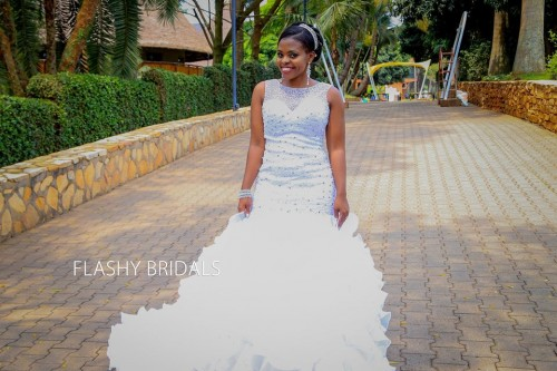 A beautiful bride clad in a sleeveless fitting mermaid gown by Flashy Bridals