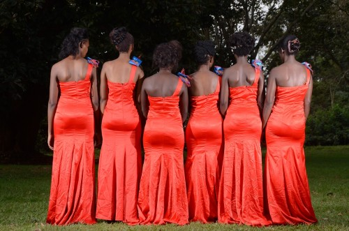 Models in red bridesmaids dresses by Lady Scarlet Bridals