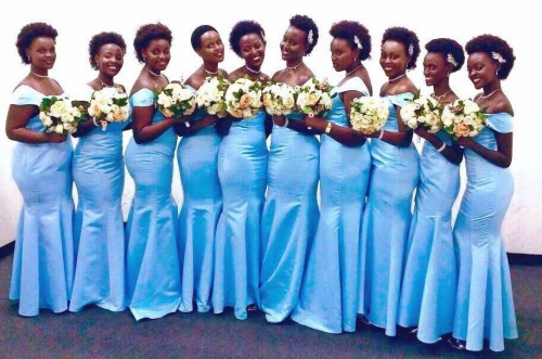 Bridesmaids in tailored outfits by Nisha's Bridals